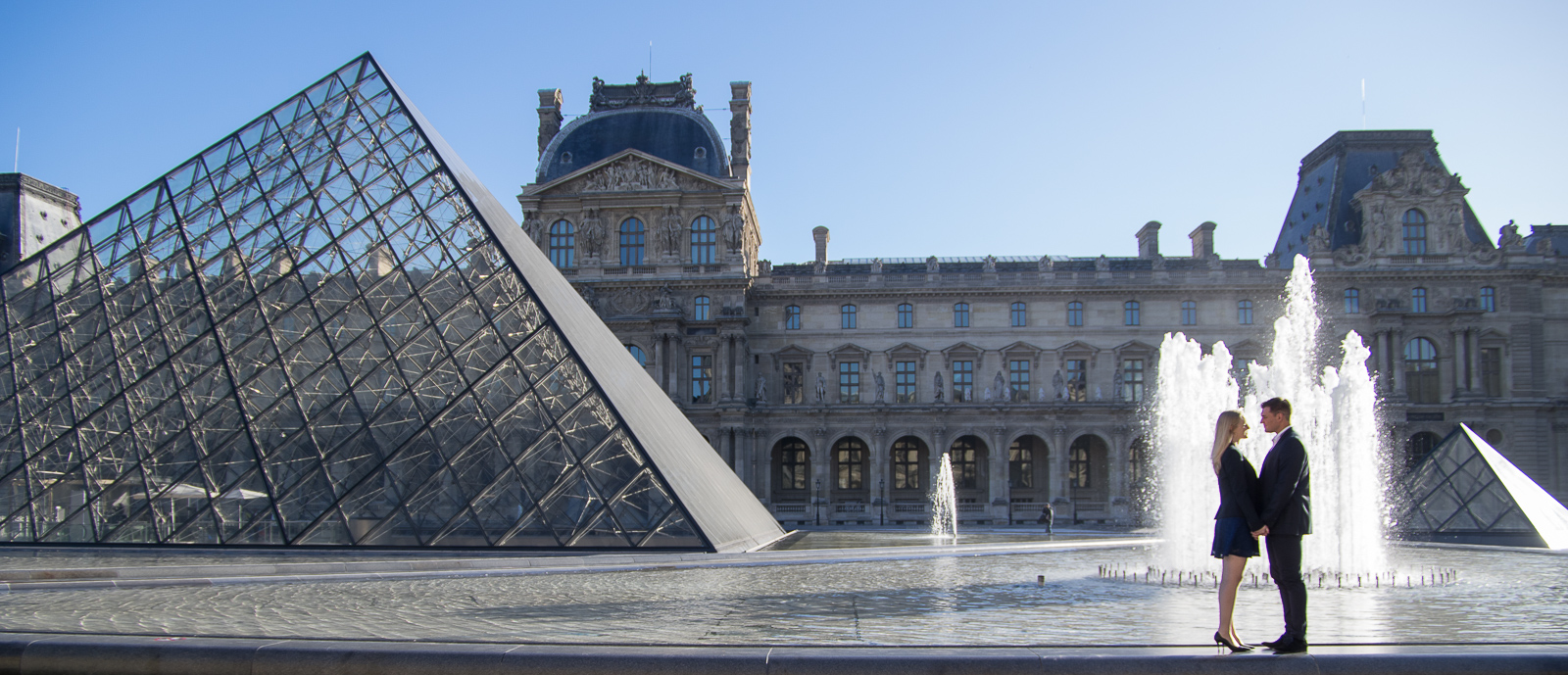 beautiful engagement in Paris with the Louvres Pyramid and the Buren columns in Palais royal