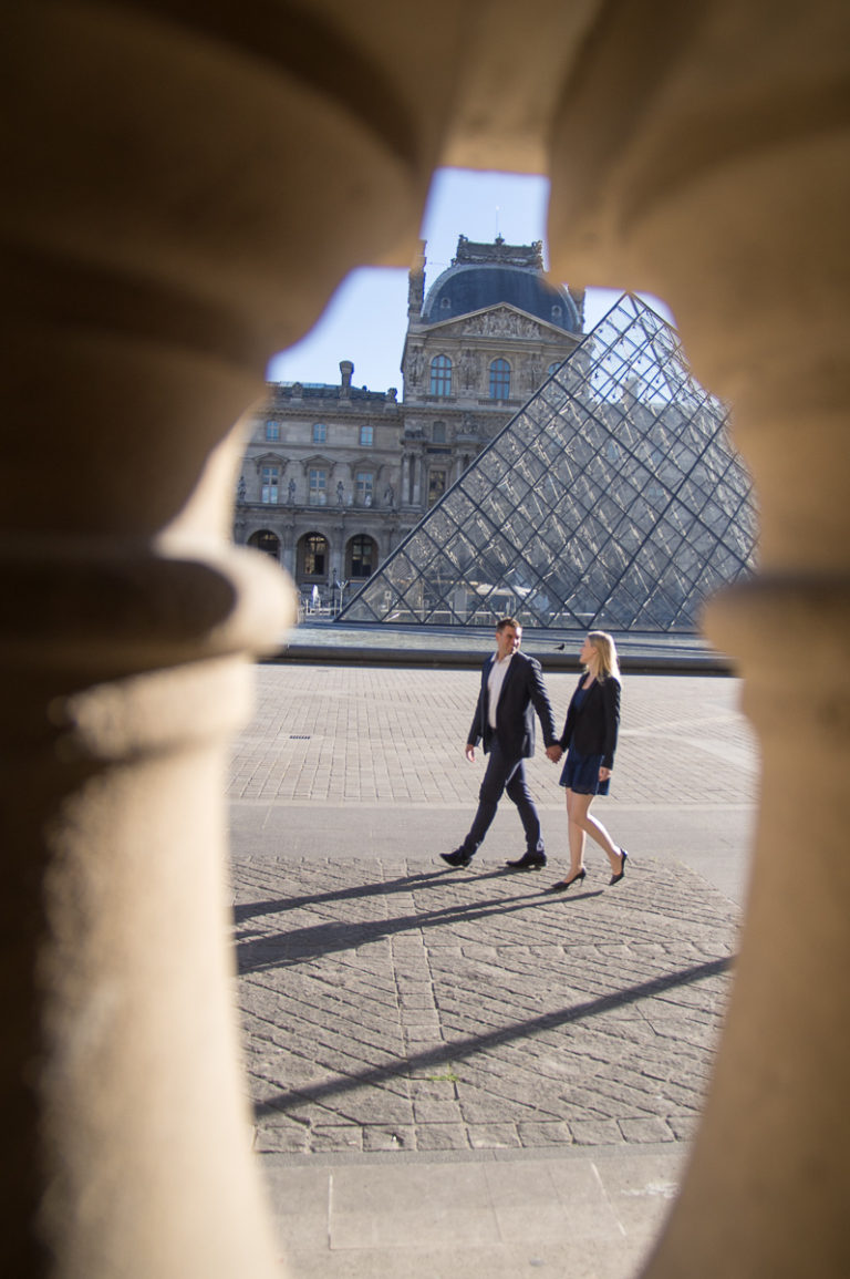 romantic couple walking in the louvres pyramid