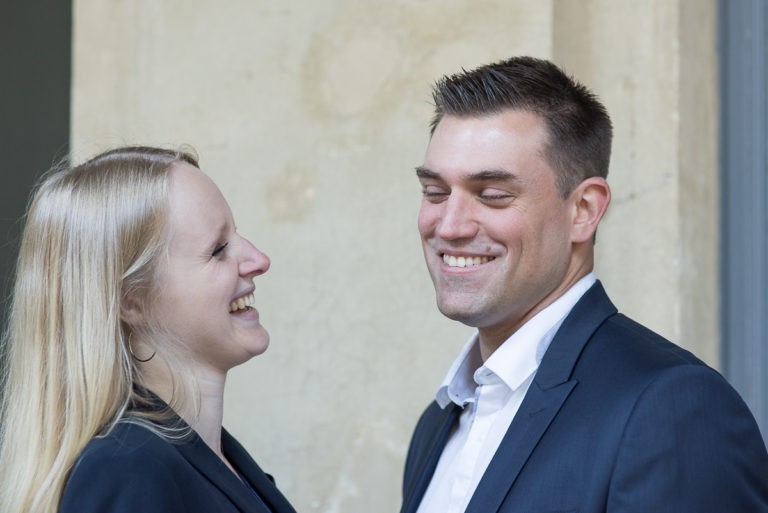 laughing lovers in engagement session in Paris